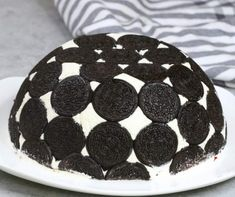 Oreo Cake - this photo shows Upside Down Oreo Cake dessert served on a plate in a beautiful, bombe-like presentation