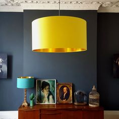 This lovely drum shade is made with a 100% cotton. Its lined with a rich and vibrant gold foil that will give a lovely warm glow to any room.