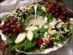Beautiful salad wreath with fruit and homemade lemon poppyseed dressing- a hot topic!