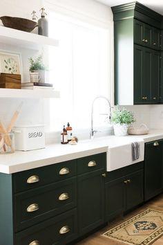 Green cabinets vintage rug kitchen