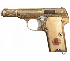 Extraordinary gold damascened Astra 300 pistol with pearl grips. Sold at Auction: $7,000. Historic Firearms, Antique Guns, & Curiosities.