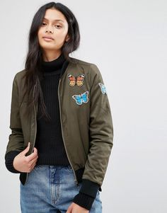 Buy it now. Brave Soul Khaki Bomber Jacket With Butterfly Badges - Green. Jacket by Brave Soul, Stretch woven fabric, Ribbed collar, Zip fastening, Functional pockets, Butterfly patches, Ribbed cuffs and hem, Regular fit - true to size, Machine wash, 97% Polyester, 3% Elastane, Our model wears a UK S/EU S/US XS and is 174cm/5'8.5 tall. , chaquetabomber, bómber, bombers, elbowdiamond, baseball. Green Brave Soul bomber jacket for woman.