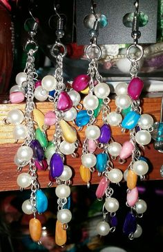 Check out this item in my Etsy shop https://www.etsy.com/listing/467789385/mother-of-pearl-dangle-earrings-jewel