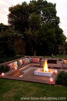 Sunken fire pit with seating. What a respite!