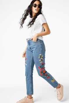 High-waisted, '90s fashion dream jeans. Classic cotton with a (slightly) tapered leg and a little embroidery for the most on-point, throwback denims. • Mom jean • high waist