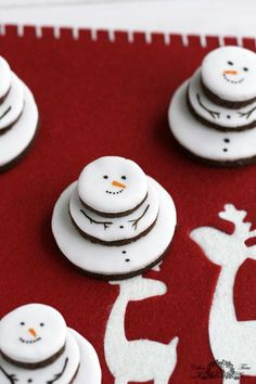 Stack iced cookies to make 3-D snowmen. You can paint on the dainty little faces with a small brush and food coloring.