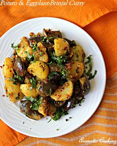 Potato and Eggplant Curry: serve warm with rice and dal (vegan).