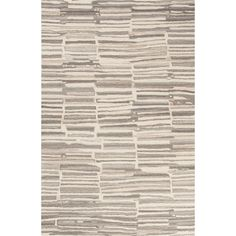 Draw your own conclusions: Subtle shades of rutabaga and aluminum create a mesmerizing abstract design suitable for any clean contemporary space. Hand-tufted 100 percent wool imparts both a soft hand ...