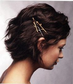 wavy short hair, side view, partially pinned back with bobby pins