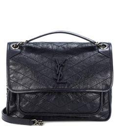 SAINT LAURENT Medium Niki Monogram leather shoulder bag. #saintlaurent #bags #shoulder bags #leather #lining #
