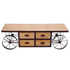 Handcrafted four-drawer wood coffee table with functioning metal wheels. Perfect for small spaces and it has storage!