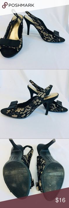"""Fioni Night Haylee Black Lace & Gold Slingbacks These elegant pumps by Fioni Night are perfect for a night out or a chic everyday! With a black floral lace pattern over a satiny gold material, they are open-toed, slingback, with bows atop the toe portion. The heels are 4"""", and they are really quite comfortable! They have been worn, but only a few times, and show very little wear.  Like the item but not the price? Make me an offer!  Remember to bundle your likes and save! FIONI Clothing Shoes…"""