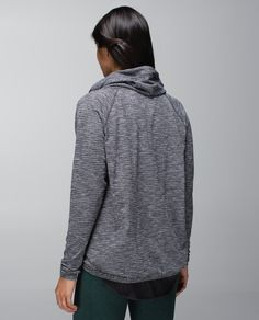 Sometimes trying to get a tight shirt over sticky, post-yoga skin can create some awkward moments in the locker room. We designed this warm, buttery-soft pullover with a slim fit so we can we can easily get it on, skip the shower lines and head on home.