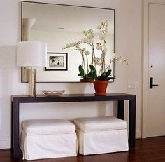 Nicely furnished entry. Great mirror