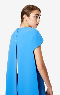 Full-length fitted short sleeve cape dress with a long tailed back with a deep split and covered buttons, all in bluette stretch heavy crepe. Safiyaa, Wedding Theme Inspiration, Cape Dress, Covered Buttons, Workout Shorts, Stretch Fabric, Short Sleeves, Elegant Designs, Model