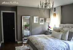 This beautiful floor mirror from #HomeGoods was one of my favorite additions to this gray guest bedroom. #sponsored #HappyByDesign #HomeGoodsHappy