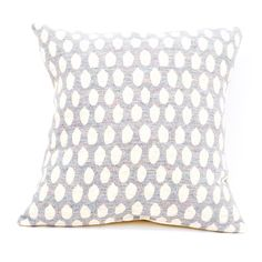 Crafted in the UK from start to finish, the Elca merino lambswool cushion is woven in Lancashire and washed in the Yorkshire Dales before being stitched together in Nottingham. Beautifully soft, the simple pattern of rough polka dots evokes abstract  illustrations creating a textured surface through its jacquard woven design.