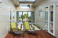 An internal courtyard creates an inviting space. Flanked with Stria® Cladding by James Hardie