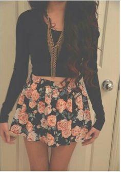 Black top with floral skater skirt.