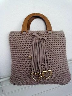 """The location where building and construction meets style, beaded crochet is the act of using beads to decorate crocheted products. """"Crochet"""" is derived fro Crochet Tote, Crochet Handbags, Crochet Purses, Bead Crochet, Handmade Kids Bags, Hand Knit Bag, Crochet Shoulder Bags, Handbag Patterns, Knitting Blogs"""