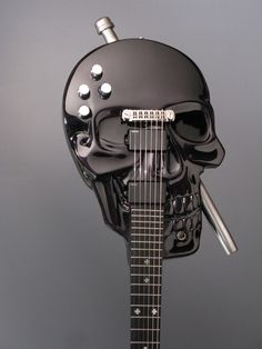 "Skull Baritone Electric Guitar - ""Maker Aaron Andrew was given one instruction from his customer, the shape ""had to be an anatomically correct Skull""."""
