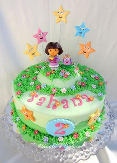 Customdesignedbirthday cake   for a young Dora The Explorer fan!   Dora and Backpack are surrounded by   handcrafted & edible 'estrell...