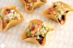 Mini taco bowls made on the bottom of a cupcake pan.  Bake at 375 for 8-10 minutes