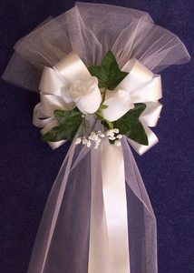 Pew bows. I like the flared top. Simple blue ribbon bow in place of roses.