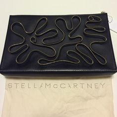 """New Stella McCartney black & gold zipper clutch Vegan friendly brand new Stella McCartney clutch retail $1035! All of my items are always authentic. Large size approx 13"""" x 8"""" x 2"""" Stella McCartney Bags Clutches & Wristlets"""