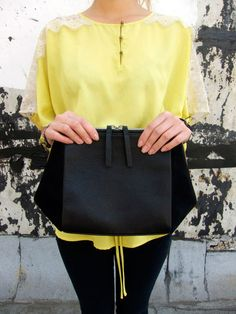 http://www.cloudcloudny.com/collections/all/products/black-tetra-clutch