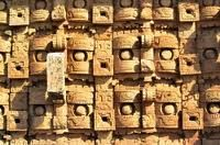 Kabah, Puuc Route, close up of wall of rain-god (Chac) masks.  Yucatan.