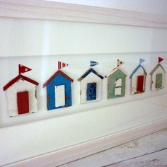 Framed driftwood beach hut collage
