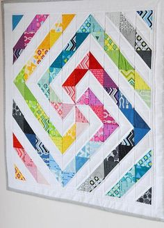 half square triangle block Down Grapevine Lane: Rainbow swirl quilt Gorgeous scrappy HST quilt--I adore the layout!--did not actually find this on the site, but it would make a great baby quilt Mais Down Grapevine Lane~~What a fun and beautiful layout for Mini Quilts, Scrappy Quilts, Easy Quilts, Quilting Tutorials, Quilting Projects, Quilting Designs, Sewing Projects, Quilting Ideas, Sewing Tutorials