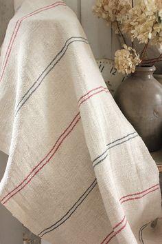 Wonderful nautical beach house interior , red and blue striped grain sack fabric from Europe ~ Lovely herringbone weave ~ hand made, homespun ~ www.textiletrunk.com