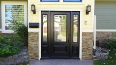 Royston glass insert by Trimlite, Black coloured single entry door with two sidelites.
