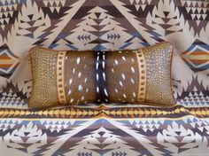 STARGAZER MERCANTILE: Camel Tan and Russet Wide Bolster Pillow with Axis Deer