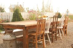 Rustic farm table with mismatched chairs and bench