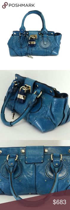 """Chloe- Teal Leather Shoulder Bag Teal Shoulder Bag Made in Italy 2 outer open pockets & 1 inner zip pocket Top opening w/magnetic snap buttons & zip closure Silver-tone hardware Blue & silver lock w/Chloe logo Metal feet across bottom of bag Double handles Distressed leather 1 small discoloration spot on front near opening and 2 near round detail Comes w/original dustbag Height 9"""" Width 17"""" Depth 9.5"""" Strap drop 8"""" Chloe Bags Shoulder Bags"""