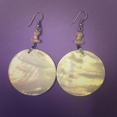 Gorgeous shell earrings! Beautiful shimmery shell earrings! Pretty neutral color will match any outfit! Express Jewelry Earrings