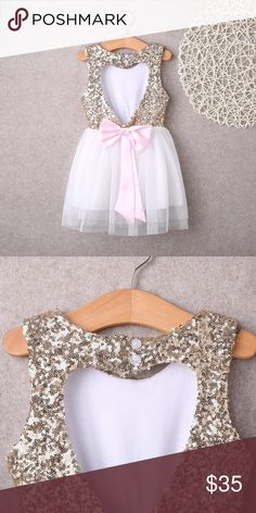 Toddler Girls Heart Breaker Dress 5/5T Shimmer + Shine <3  Beautiful dress with a heart cutout back. Pink bow tie below heart. 2 buttons to open at the neck. Beautiful sequins above soft mesh layers. Item originates from China. Please ask all questions before purchasing. Dresses