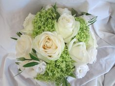 Mallorca style bouquet of white roes, white lisianthus, olive and snowcap hydrangea