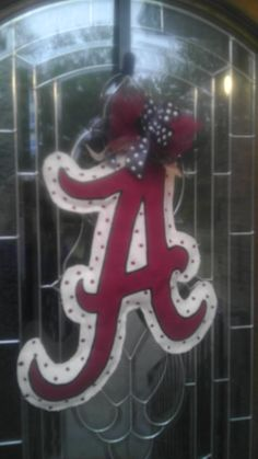 Alabama A burlap door hanger. It would be fun to use school color felt (around plastic canvas stiffening) to do school letters to hang in support on game days and at tourney time. Could even hang from luggage hook in back seat of car without blocking view. I smell a fundraiser idea if this works up nicely.