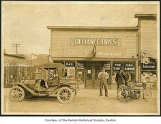 M&H tire shop 1912 in Renton, WA showing and Excelsior (photo - MOHAI)