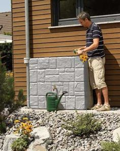 RainHarvest Systems makes this Stone Grey Wall Tank for collecting rain water.  It holds 90 gallons.