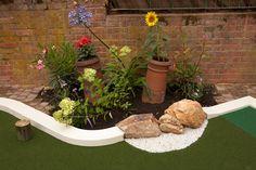 Planting arrangements by UrbanCrazy Golf Putting Green, Crazy Golf, Miniature Golf, Back Gardens, Water Features, Garden Bridge, Golf Courses, Backyard, Outdoor Structures