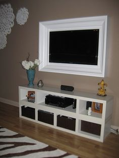 Love this idea of framing your TV...and no wires showing!!