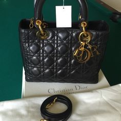 Christian Dior Authentic Lady Dior Handbag Vintage CD Lady Dior handbag in size medium, black lamb skin. Includes original receipt, tags, box and dust bag.  Rarely used.  Also includes never used shoulder strap.  New bag is $4100.  I have posted the bag separate from set listing due to overwhelming emails requesting individual listings. Dior Bags Totes