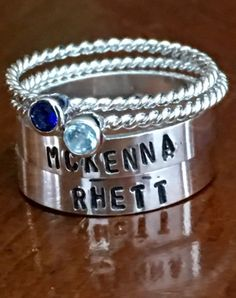 Mothers set of name and birthstone rings to represent your two children. Personalized with their name and birthstone to make a special gift for a mom to treasure forever.  Sterling silver ring set includes two hand stamped stackable rings and two rhodium plated birthstone rings.  Add more birthstone rings or hand stamped rings by visiting our Stackable Rings section: https://www.etsy.com/shop/kandsimpressions?section_id=11022682&ref=shopsection_leftnav_3  - H...