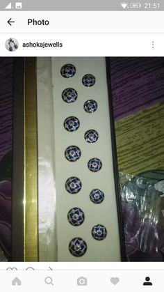 Button set in silver stted with diamonds and enamel work