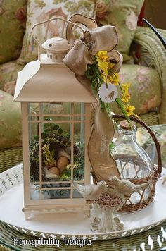 lantern, jug, burlap bow, birds on a try...so many of my favorite things